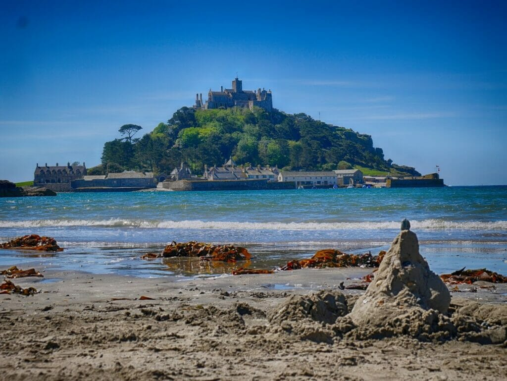 St Michaels Mount with a sandcastle in front